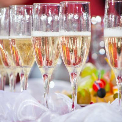 Close up photo with glasses of champagne on festive table